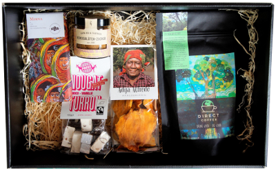 Gift box with products from direct trade: coffee, chocolate, mangoes, nuts and spices